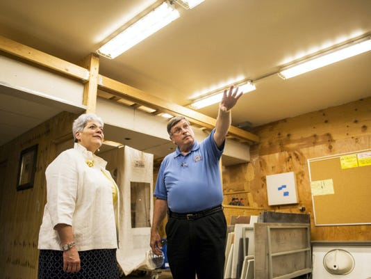 Robert Zukovich, coordinator/instructor at the Carpenters Training and Educational Fund of Greater Pennsylvania, gives a tour of the facility to Pennsylvania Labor and Industry secretary Kathy Manderino Tuesday.