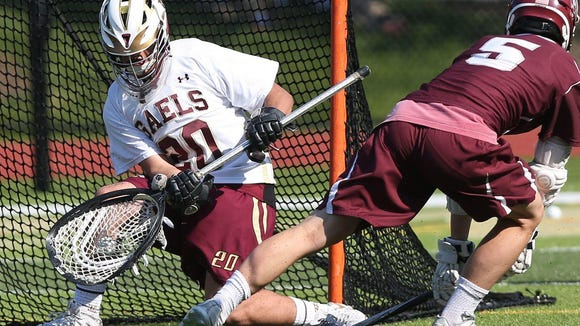 Iona's Joe Persico (20) stops a shot from Fordham's James Murray (5) during first half action during the CHSAA AA championship game at Iona Prep in New Rochelle May 17, 2017. Iona won the game 8-4.