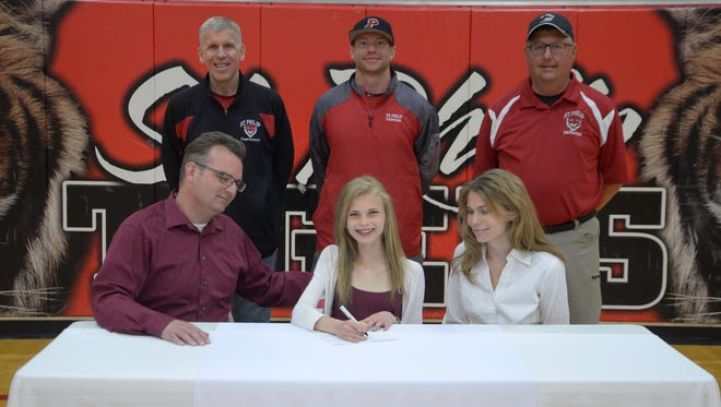 St. Philip's Ava Strenge (center) signs a National Letter of Intent to run at Mississippi State University.
