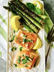 This simple skillet dinner of seared salmon and asparagus can be on the table in less than 20 minutes.