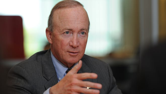 Purdue University President Mitch Daniels is a former governor of Indiana and President George W. Bush's first budget director.
