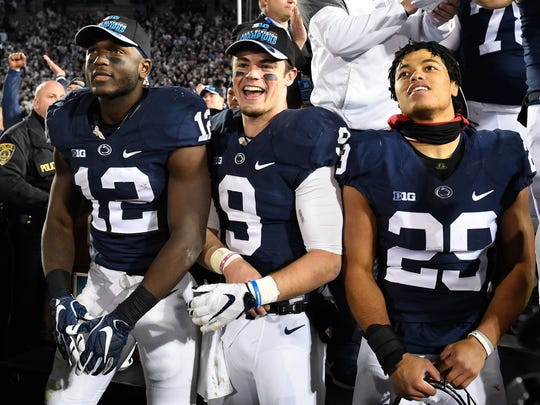 Nittany Lions wide receiver Chris Godwin (12), quarterback Trace McSorley (9) and cornerback John Reid (29) celebrated after defeating Michigan State.