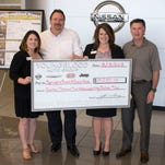 Pictured, from left: Staci Holland, program director, Ronald McDonald House Charities of the Ozarks; John Widiger, general manager, Youngblood Auto Group; Bonnie Keller, president and CEO, Ronald McDonald House Charities of the Ozarks; and John Youngblood, owner, Youngblood Auto Group.