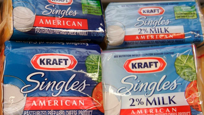 """Kraft Singles products on display at a market in Palo Alto, California on Feb. 2, 2009. Kraft Foods and the Academy of Nutrition and Dietetics have decided to end a partnership that put the dietitian group's """"Kids Eat Right"""" logo on Kraft Singles because """"misperceptions are overshadowing the campaign,"""" Kraft said in a statement Tuesday, March 31, 2015."""