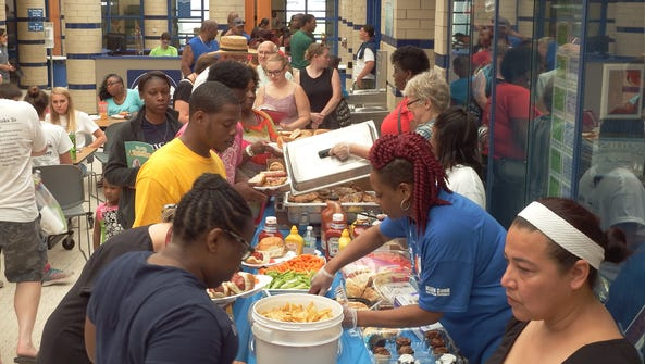 A crowd takes to the free food at the Iowa City Area