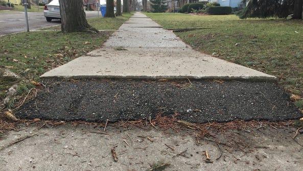 This photo taken Monday shows a sidewalk at Madison