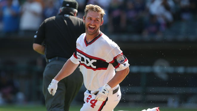 Chicago White Sox first baseman Matt Davidson (24) celebrates after hitting a walk-off home run during the ninth inning against the Cleveland Indians.