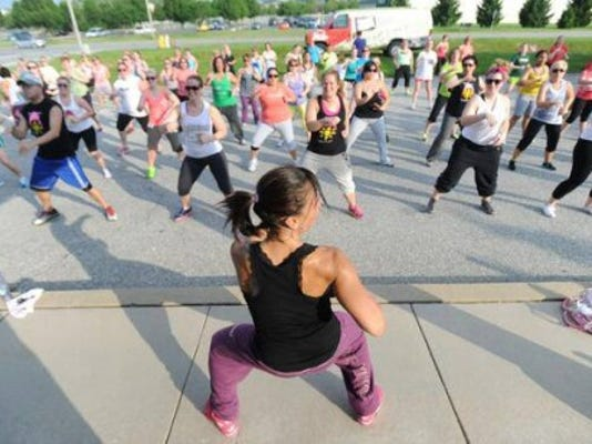Monica Melendez instructs free Zumba class during No Sweat in the Park in May at the York Daily Record. About 1,000 people attended our free fitness series this summer. (Daily Record/Sunday News -- Jason Plotkin)