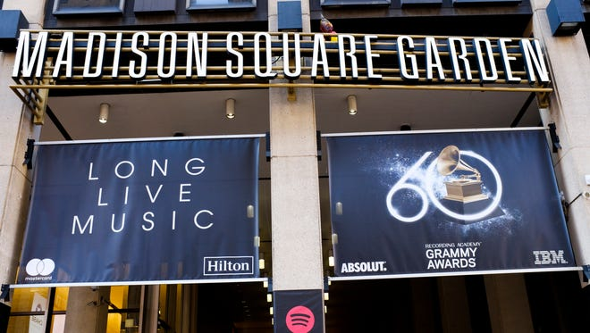 Promotional banners for the 60th Annual Grammy Awards hang over an entrance to Madison Square Garden in New York City.
