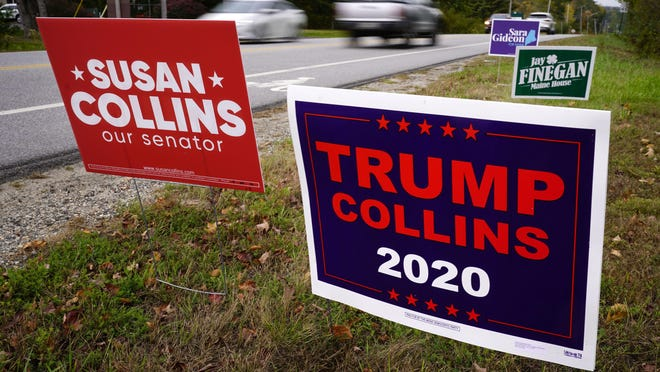 "A ""TRUMP COLLINS 2020"" sign, right, paid for by the Maine Democratic Party, stands alongside a ""Susan Collins our senator"" sign, paid for by the Maine Republican Party, Wednesday, Oct. 7, 2020, in Freeport, Maine.  Sen. Collins, R-Maine, is being challenged by Democrat Sara Gideon."