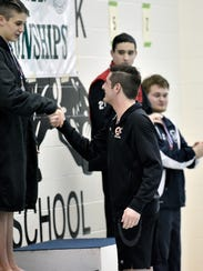 Central York's Garrett Sommer, center, shakes hands