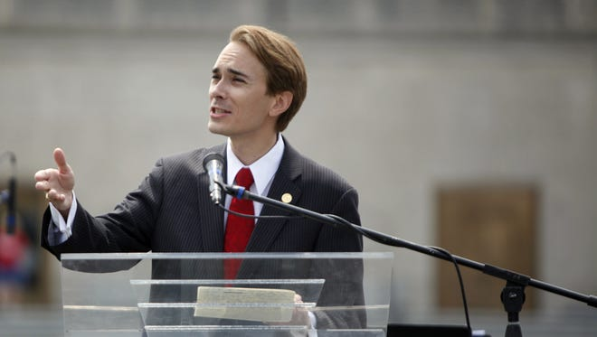 Senator Brent Waltz speaks during the FreedomWorks rally for Richard Mourdock Saturday, May 5, 2012 at Veterans Plaza in downtown Indianapolis.  Danese Kenon/The Star