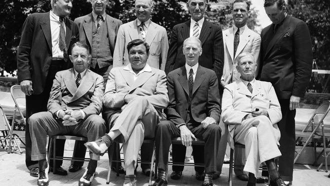 File - In this June 12, 1939 file photo, these baseball stars were pictured as they attended the dedication and their induction into the Baseball Hall of Fame in Cooperstown, N.Y. Front row; Eddie Collins, Babe Ruth, Connie Mack, Cy Young; Rear row left to right; Hans Wagner, Grover Cleveland Alexander, Tris Speaker, Napoleon Lajoie, George Sisler and Walter Johnson. A baseball with the signatures of Babe Ruth, Ty Cobb, Honus Wagner and eight other legends of the game has sold for more than $600,000. The players all signed the ball on the same day in 1939, when they had gathered to become the first class to enter the Baseball Hall of Fame. SCP Auctions said Monday, Aug. 13, 2018, that it has sold for just over $623,000. That crushes the previous record of $345,000 for a signed ball, set in 2013. (AP Photo/File)
