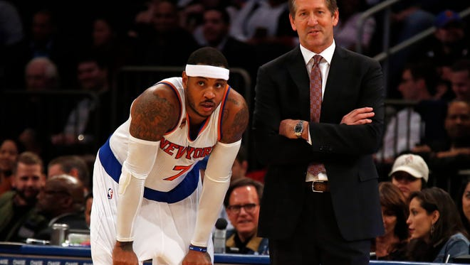 Knicks head coach Jeff Hornacek and Knicks forward Carmelo Anthony during a break in the action at a recent game in Madison Square Garden.