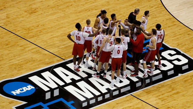 Wisconsin players meet at center court during practice ahead of a first-round men's college basketball game in the NCAA Tournament, Thursday, March 17, 2016, in St. Louis. Wisconsin plays Pittsburgh on Friday.
