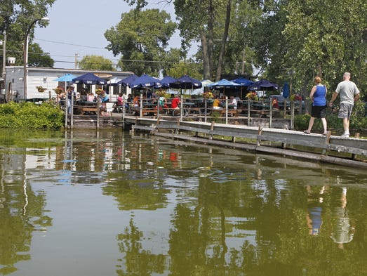 Customers arrive by boat, bike and car at the popular Bay Side Pub on Lake Road in Webster.