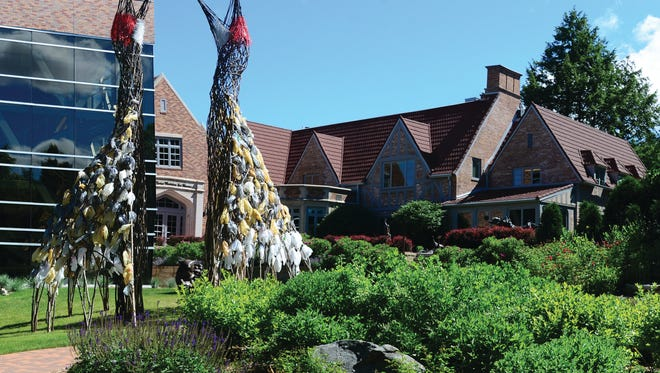 """The Dance,"" a sculpture of two sandhill cranes by Donna Dodson and Andy Moerlein, greets visitors to the Leigh Yawkey Woodson Art Museum in Wausau."