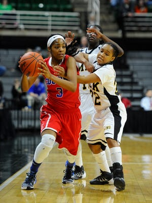 Cousino's Kierra Fletcher works out a double team of King's Micaela Kelly and Alicia Norman in the third quarter.
