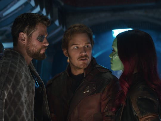 "Welcome to the Guardians' galaxy: Thor (Chris Hemsworth, left) meets up with Star-Lord/Peter Quill (Chris Pratt) and Gamora (Zoe Saldana) in ""Avengers: Infinity War."""