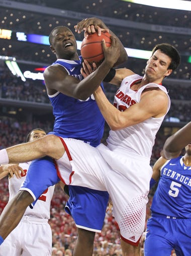 Kentucky's Julius Randle battles Wisconsin's Duje Dukan for a rebound Saturday night at the Final Four at AT&T Stadium in Arlington, Texas. April 5, 2014