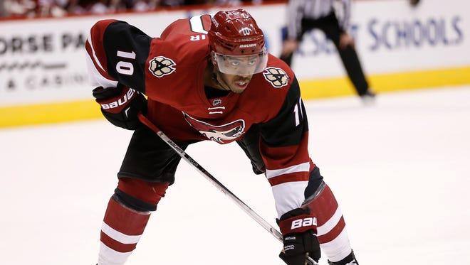 Arizona Coyotes forward Anthony Duclair (10) lines up for a faceoff against the Buffalo Sabres during the second period at Gila River Arena in Glendale, Ariz., on January 18, 2016.