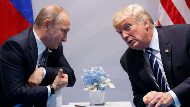 """In this July 7, 2017, file photo, President Donald Trump meets with Russian President Vladimir Putin at the G-20 Summit in Hamburg. Trump signed on Aug. 2, what he called a """"seriously flawed"""" bill imposing new sanctions on Russia, pressured by his Republican Party not to move on his own toward a warmer relationship with Moscow in light of Russian actions."""