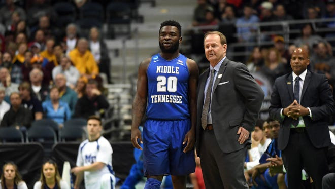 Middle Tennessee Blue Raiders guard Giddy Potts (20) and head coach Kermit Davis talk during the second half of the game in the first round of the 2017 NCAA Tournament at BMO Harris Bradley Center.