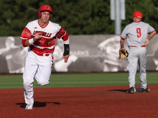 U of L's Brendan McKay (38) heads for third base against