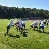 Prep football: Patriots aim to fill holes in offense
