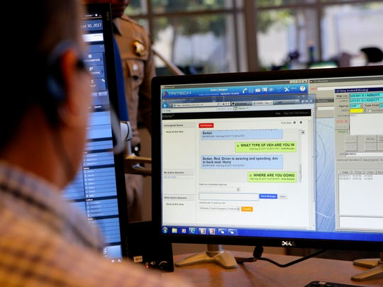 A dispatcher participates in a live demonstration of the text to 911 service during a press conference at the California Highway Patrol Salinas office on Wednesday.