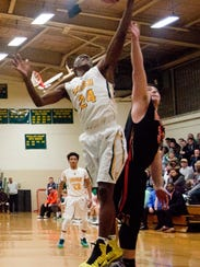 York Catholic's Malik Martin (24) skies for a rebound