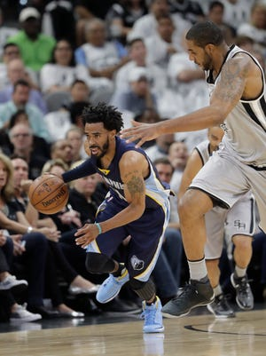Memphis Grizzlies guard Mike Conley (11) drives around San Antonio Spurs forward LaMarcus Aldridge (12) during Game 1 of a first-round NBA basketball playoff series, Saturday, April 15, 2017, in San Antonio.