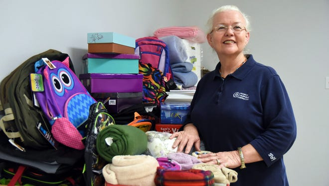 Linda Rogers travels on mission trips to Kentucky and New Mexico bringing blankets, clothes and food to poverty stricken areas.