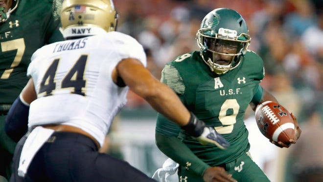 South Florida QB Quinton Flowers takes off on a second-quarter run Friday night.