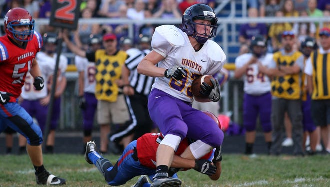 Unioto's Gabe Fisher breaks a tackle after a reception during last week's 36-20 loss to Zane Trace in Kinnikinnick. The Shermans will visit Paint Valley in Week 5.