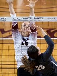 New Mexico State middle blocker Hanna Combs keeps her