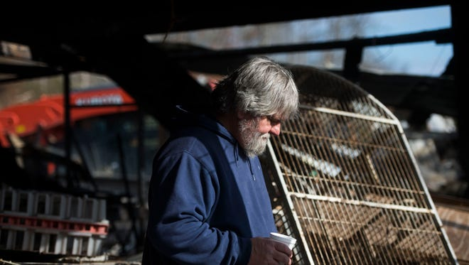 Little Ponderosa Zoo founder James Cox looks at what is left of the zoo's main barn, in Clinton, Tenn., Thursday, Dec. 14, 2017. Little Ponderosa Zoo continues to recover after an electrical malfunction caused a fire at the back of its main barn, killing about 45 animals on Dec. 4.