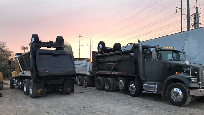 A man was transported to a hospital with life-threatening injuries after being pinned between two dump trucks in Peoria on November 13, 2017.