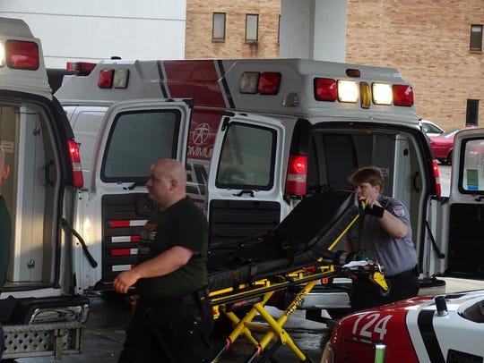 Workers wheel a gurney into Good Samaritan Hospital