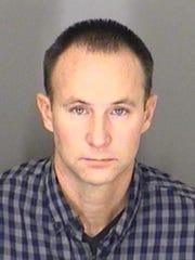 Off-duty Warren firefighter Tad Alan Dennis was arraigned