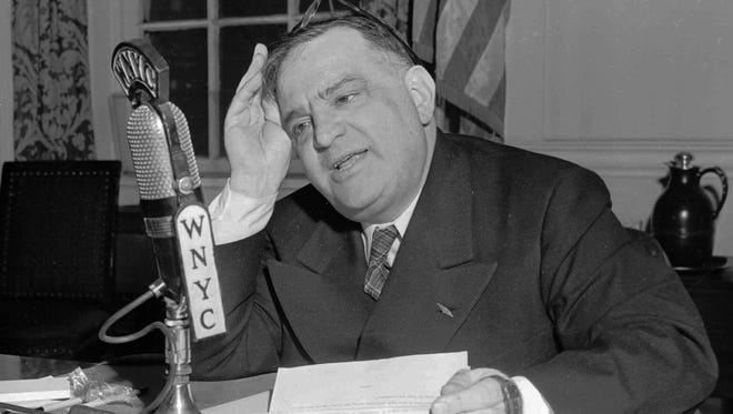 Seated at his desk in City Hall, Fiorello H. LaGuardia makes his final radio talk to the people of New York as mayor Dec. 30, 1945.