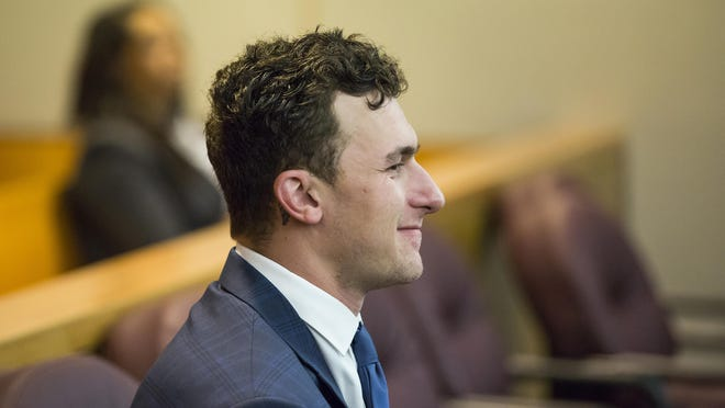 In this May 5, 2016 file photo, former Cleveland Browns NFL quarterback Johnny Manziel sits while his defense attorneys confer with the prosecution during his initial hearing in Dallas. Manziel's representatives say the troubled quarterback was involved in a hit-and-run accident, and that the former Texas A&M star wasn't seriously injured. Manziel's publicist, Denise Michaels, said the former Cleveland player reported the incident to police, but attorney Bob Hinton says Dallas police deny that a report was filed. It wasn't immediately clear when or where the accident happened. (Smiley N. Pool/The Dallas Morning News via AP)