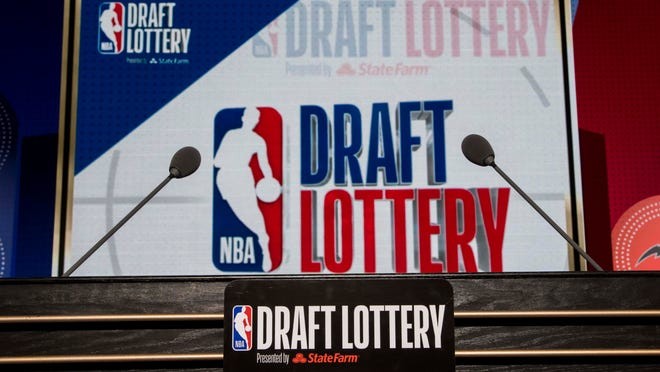 The podium with logos is seen prior to the 2018 NBA Draft Lottery on Tuesday at the Palmer House Hilton in Chicago.