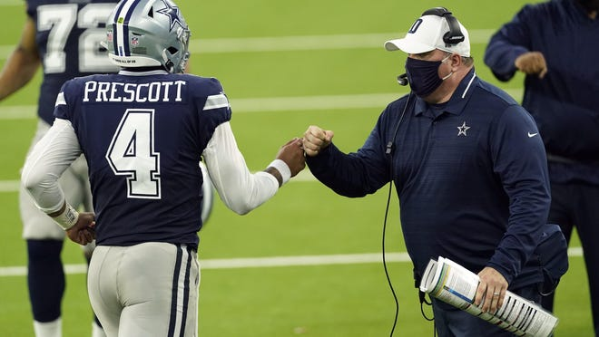 Dallas Cowboys head coach Mike McCarthy bumps fists with quarterback Dak Prescott during the first half of their season-opening loss Sunday night against the Los Angeles Rams. Dallas can even its record at 1-1 with a win over Atlanta on Sunday.