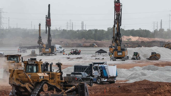 Crews work at the site of the new Tesla assembly plant in Travis County last month.
