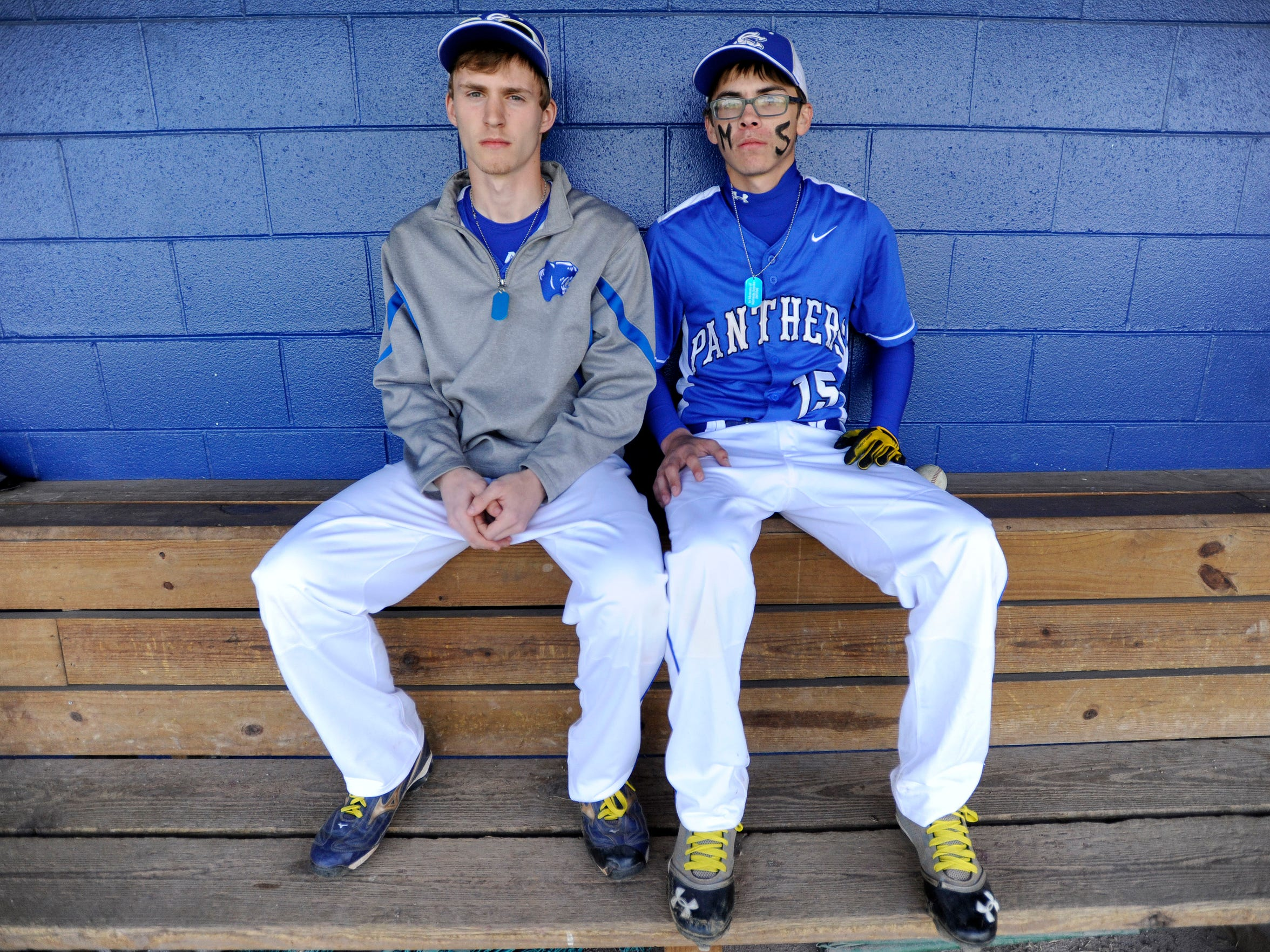 Southeastern's Justin Dye and Alec Pinkerton sit in