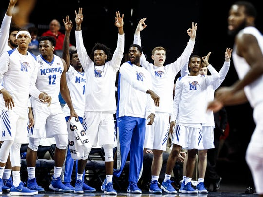 The Memphis bench celebrates a made three-pointer during first half action against Tulane at the FedExForum in Memphis Tenn., Tuesday, January 9, 2017.