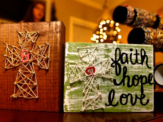 Hannah Nelson makes string art on wooden boards to raise funds for Ronald McDonald House, as well as for research for PHACE syndrome and moyamoya disease.