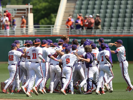Clemson players celebrate a 2-1 victory against No. 9 N.C. State Sunday afternoon at Doug Kingsmore Stadium.