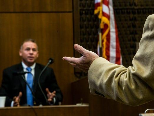 October 13, 2017 - Lead prosecutor John Champion, right,